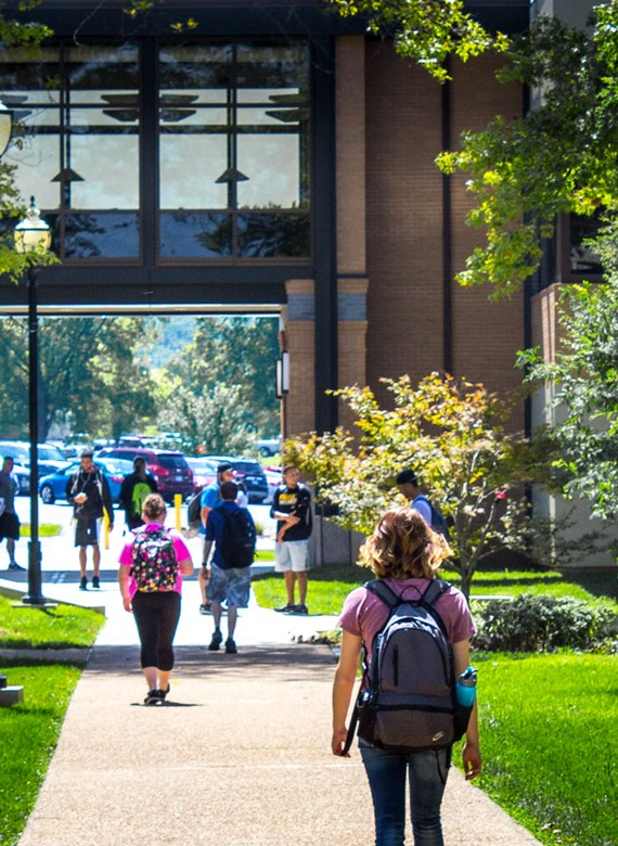 Image shows students walking through Mineral Area College's outdoor quad