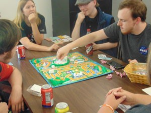 Upward Bound students playing the board game Life